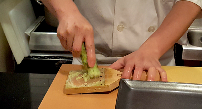 Best Sushi Restaurant in New York- Sushi Nakazawa, Chef is grinding fresh wasabi.