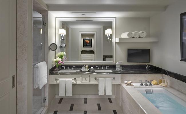 The best hotel in Atlanta- Mandarin Oriental Atlanta- all marble bathroom with deep soaking tub, separate shower, huge vanity and some have windows overlooking Atlanta skyline.